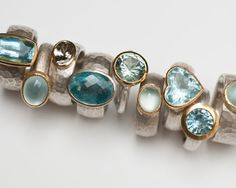 Rings in sterling silver, 18 carat yellow gold, aquamarine.