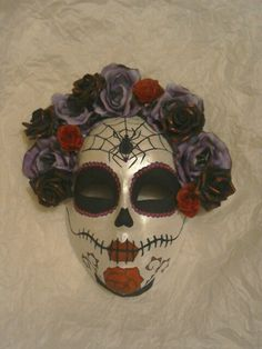 This is a Day of the Dead/Sugar skull mask i made for my friend's 18th birthday. Kinda proud of it!