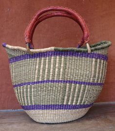 Patterned shopping basket with leather-bound handles, Burkino Faso.