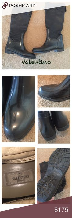 Valentino Garavani leather rain boots Valentino Garavani rubber and leather rain boots , they have back zippers , the rubber is worn in spots and has scratching , I have not tried to see if they could be buffed out , the leather is gorgeous size 40 , they are sold as is No Trades ! Valentino Garavani Shoes