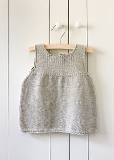 Clean + Simple Baby Dress Few things prompt knitters into action more than the arrival of a new baby. The opportunity to express our love and excitement with something that we've made by hand is just too tempting! More