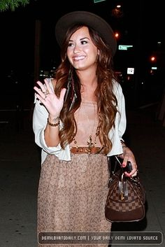 Demi Lovato wearing her House of Harlow long coin necklace.