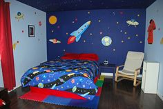 Kids Space Themed Bedroom Ideas - painted mural. Like the dark blue wall and rest left light.