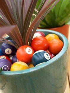 Take a Cue - Pool balls were used to add a punch of color to green potted plants. Find other unusual items at flea markets, yard sales, and secondhand stores to bring character to your own outdoor spaces. As these planters prove, your accents don't have to be huge to make a fun impact. (But you may want them to be weatherproof!)
