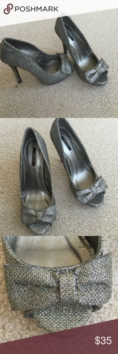 Forever 21 brand new silver sparkle heels shoes 7 Forever 21 silver sparkle heels shoes brand new never worn super cute heels, size 7 🙅🏻 PLEASE DO NOT ASK LOWEST PRICE 🙅🏻 ------------ Instead ---------------- ✅ USE OFFER BUTTON ✅ --------😐 no low balling please😐-------- 💁🏻 NO DRAMA HERE LETS BE NICE 🤗 🚫🚭 SMOKE FREE - PET FREE HOME 🚫🐾 Forever 21 Shoes Heels
