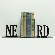 Nerd Alert Bookends, Dot & Bo . Are you nerdy and proud of it? Showcase your nerdiest novels—or textbooks—in these celebratory bookends. They're handmade from solid steel for a long-lasting set.