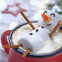 Hot Chocolate fun with a floating marshmellow snowman with candy corn nose and pretzel sticks. Adorable sweet treat!