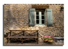 French country cottage. The stone walls and quaint window!!!