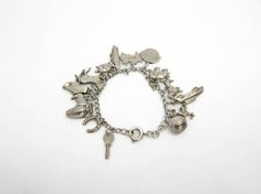 Silver Charm Bracelet 1950s 15 Charms including Animal by Aquiris