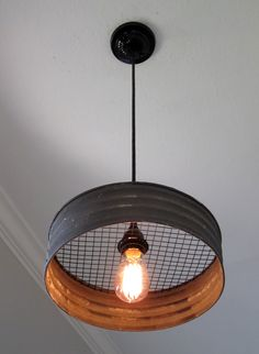 What a great light! Made with a grey corrugated metal that looks just like it came from an old farmhouse. This would make a great addition to a kitchen, laundry room, mudroom, barn, etc. The diameter                                                                                                                                                      More