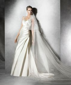 The New Design Flared wedding dress in draped satin Draped bodice with sweetheart neckline with gemstone straps front and back.  Free Measurement