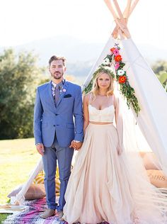Holding hands: Landon and Vanessa held hands as they stood in front of a teepee during their wedding