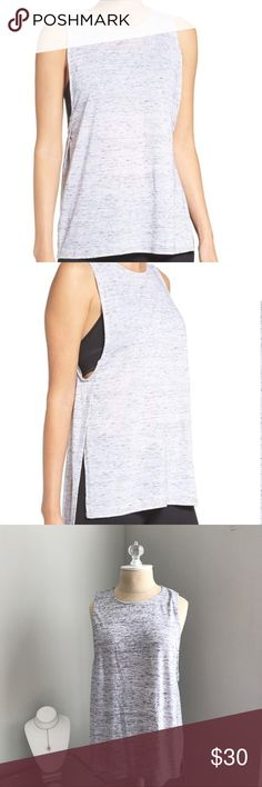 Zella Muscle Tee NWOT Zella muscle tee. Crewneck, sleeveless. Has deep cut armholes and long side slits, super lightweight. 95% polyester, 5% cotton. Never worn, like new!                       •n o  t r a d e s• •s m o k e  f r e e / p e t  f r e e  h o m e•   •s a m e / n e x t  d a y  s h i p p i n g• Zella Tops Muscle Tees