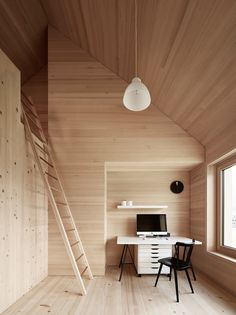 Spruce wood also lines the floor, walls, and ceiling in the bedrooms. The residents must climb a ladder to access the loft above.