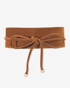 "Crafted in luxurious suede in a rich candied walnut hue, our latest obi belt adds a little boho romance to your look. Wrap it around billowy blouses for a waist-defining finish. It's also a nice way to add interest to a simple look like a sheath dress.  Suede obi belt in candied walnut Sized at the waist Wraps around the back to a tie front with goldtone ends Approx. 2 3/4"" at widest point; tapers to ¾"" Suede Imported"
