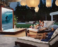 Outdoor movie night. Oversized, retractable projection screen. Store screen inside when not in use. Love the oversized chaise lounge chairs.