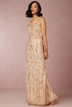 BHLDN. With a blouson silhouette and beads and sequins stitched upon champagne tulle, this stunning dress evokes the era of brass bands and extravagance.