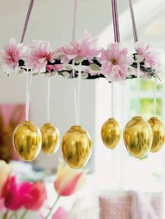 Easter skins hanging from chandelier. Sooooo cuuuuuute!!! I think I will have white flowers with touch of yellow/gold color in another smaller flower. Could use any color tho like blue, pink or green.