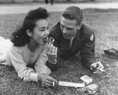 US soldier and japanese girl sharing a chocolate bar and cigarettes.---- My mother was disowned by her family for marrying an American soldier.