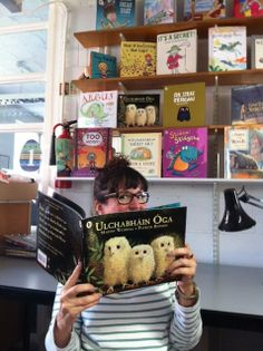 Here's Deirdre McDermott, picture book publisher, reading ULCHABHÁIN ÓGA the moment a printed copy arrived in the office. She actually worked on this book's design when it was first published into English! Can you spot a few more Irish titles on the shelves behind her head? Irish Language, Baby Owls, Book Publishing, The Office, Book Design, Your Child, Little Ones, Illustrators, This Book