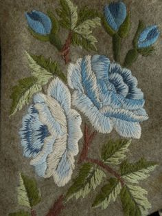 a blue rose machine embroidered