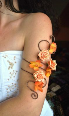 I have made a matching pair of upper arm cuff and lower slave bracelet arm cuff in a flower and vine whimsical woodland style. This order is for