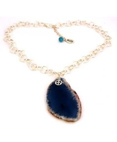 "This Natural Agate crystal necklace comes in a selection of exotic colors. The Agate crystal pendant includes a 925 Sterling silver peace charm. The chain is an Italian made round links Sterling Silver chain. Each piece is unique and one of a kind. The links necklace is 16"" in length and includes an 1.75"" extension with Turquoise bead."