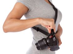 I like the idea of this one for my Rebel XT --- Camera Straps for Women: UltraFit Sling Strap for Women by JOBY