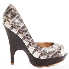 Heels.com:  These unforgettable heels from Bebe are sure to make you the life of the party. Brice is a pump in natural snakeskin-textured leather featuring an open toe and a D'Orsay style single-side design. A crafted 1 inch platform and connected 4 1/2 inch stiletto heel complete these phenomenal pumps.