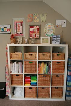 """Sewing room supplies organized in (what looks like) Ikea Expedit shelves. Could do """"craft"""" or """"create"""" words on the wall for craft room!"""