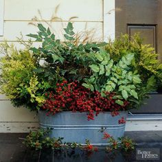 An old washtub is new again when you fill it with fall plants such as wheat stems, fir branches, and holly leaves with berries. Rest your repurposed planter on a porch, front step, or retaining wall, and enjoy.