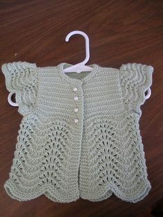 knittily's adorable sweater - cute baby sweater with feather-and-fan lace! 2 skeins of Zealana Willow DK yarn to knit Oat Couture's Angel Sweater for BabyRavelry: Project Gallery for Angel Sweater er for Baby pattern by Annie DempseyThis Pin was disc Knitting For Kids, Baby Knitting Patterns, Crochet For Kids, Knitting Designs, Baby Patterns, Free Knitting, Crochet Baby, Baby Pullover, Baby Cardigan