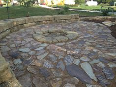 In-ground fire pit with flagstone patio and ledgerock sitting blocks. #TopekaLandscape