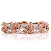 "Fashionable cuff bracelet is crafted in a combination of 18K white and rose gold, measuring approx. 7"" around the wrist (Expandable due to open ends). This captivating cuff bracelet incorporates 10 heart-motif profiles rendered 4 of which are swathed in pave-set fancy pink  diamonds approx. 5.30cts , natural pink color and almost all VS clarity. 9 oval-shaped links crafted in white gold, 5 of which are adorned with pave diamonds graded 6.10 color and G-H color, VS clarity."