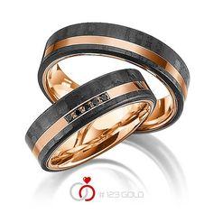 1 Paar Trauringe - Legierung: Rotgold 585/- mit Carbon-Einzug Breite: 6,00 - Höhe: 2,00 - Steinbesatz: 5 Brillanten zus. 0,05 ct. schwarz (Ring 1 mit Steinbesatz, Ring 2 ohne Steinbesatz)