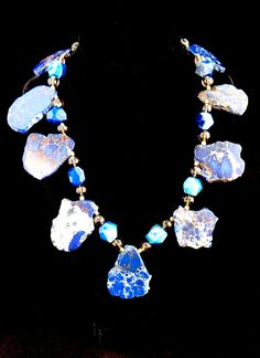 """""""Ciel Bleu"""" (Blue Heaven) features a strand of royal-blue variscite turqouise, royal- blue faceted druzy agate, premium faceted smokey quartz, and vermeil beads with a hand made vermiel toggle clasp. Something sure to turn heads!"""