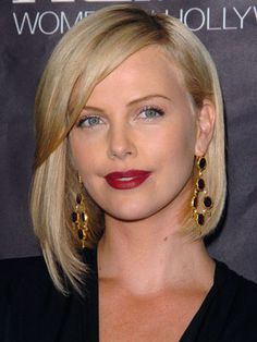 charlize theron asymmetrical bob. My next hair cut... Just have to find time to drive up to see Chelsea at work!