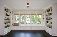 window seat with built in book cases and storage.