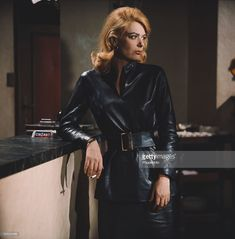 Greek actress Melina Mercouri pictured wearing a leather belted top and skirt in character as Magda on the set of the film The Victors in Greek Beauty, Joan Jett, Iconic Movies, Crazy Girls, Hollywood Stars, Style Icons, Leather Pants, Bomber Jacket, Women's Fashion