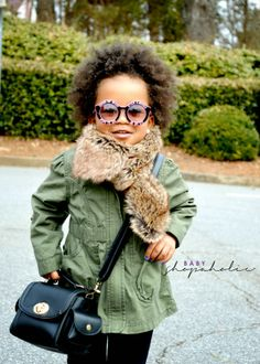 All bundled up, this young fashionista is ready to take on the day!