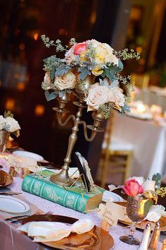Read more about wedding table flower arrangements colour Click the link to get more information. Candlestick Centerpiece, Book Centerpieces, Centerpiece Decorations, Wedding Centerpieces, Wedding Decorations, Candelabra, Vintage Centerpieces, Vintage Flower Arrangements, Wedding Arrangements