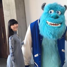I took a photo with Sully at PIXAR♪ This is young Sully back in university. Mike with braces was standing right next to us, too! FROM KASHIYUKA