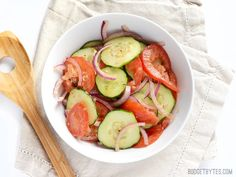 Take advantage of summer's fresh produce with this super Simple Tomato Cucumber Salad. With endless ways to customize, this recipe is a must have.