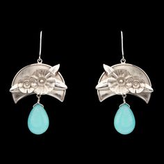 """""""These beautifully crafted earrings are a must-have in your jewellery collection. Team them with a vibrant dress.Guaranteed to turn heads.""""  #Artisan #Handcrafted #Silver #Dangle #Earrings"""