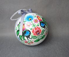 Folk style polish Christmas tree ornament with roosters. Made of acrylic, painted and decoupage decorated from inside. Finished with gray ribbon and chiffon ribbon hanger. Picture on one side, other plain. You can buy it also with a silver metal rack to hang it.  Dimensions - diameter 12cm(4 23⁄32)  READY TO SHIP - youll receive exactly the one from photos. You can find MORE CHRISTMAS decorations in this section of my shop  www.etsy.com/shop/MKedraHandmade?section_id=16855112&a...