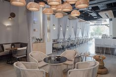 101 café / FAR OFFICE, China. White clean and modern restaurant with curtain dividers