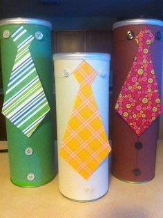 Father's Day Gift Tubes. I just made these up with a Pringles can, color paper and buttons. Then just fill with all kinds of goodies. Be Creative <3 By NLB