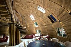 A solid timber, dome-shaped structure in Gaoming, China built as a central design hub for the Timothy Oulton company.