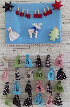 Calendário de Advento feito com feltro e tecido.