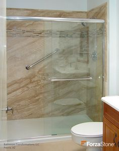 Beautiful shower renovation using ForzaStone Natural Stone French Mocha Marble with Honey Crema Deco Band - project by Bathroom Transformations, LLC in Peoria, Arizona. #bathroomremodel #bathremodel #bathdesign #showersurround #beautifulbathrooms #stoneinbathrooms #homeremodeling #homeremodel #smallbathroommakeover